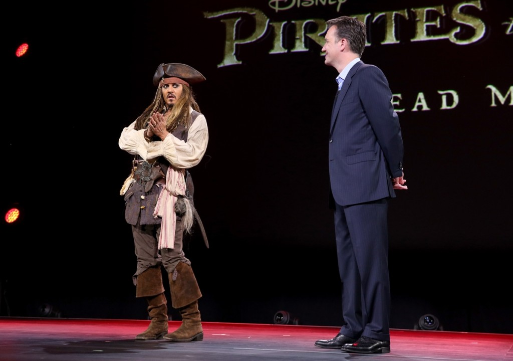"ANAHEIM, CA - AUGUST 15:  Actor Johnny Depp,  dressed as Captain Jack Sparrow, of PIRATES OF THE CARIBBEAN: DEAD MEN TELL NO TALES (L) and President of Walt Disney Studios Motion Picture Production Sean Bailey took part today in ""Worlds, Galaxies, and Universes: Live Action at The Walt Disney Studios"" presentation at Disney's D23 EXPO 2015 in Anaheim, Calif.  (Photo by Jesse Grant/Getty Images for Disney) *** Local Caption *** Johnny Depp; Sean Bailey"
