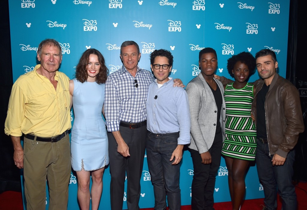 "ANAHEIM, CA - AUGUST 15:  (L-R) Actors Harrison Ford, Daisy Ridley, The Walt Disney Company Chairman and CEO Bob Iger, director J.J. Abrams, actors John Boyega, Lupita Nyong'o and Oscar Isaac of STAR WARS: THE FORCE AWAKENS took part today in ""Worlds, Galaxies, and Universes: Live Action at The Walt Disney Studios"" presentation at Disney's D23 EXPO 2015 in Anaheim, Calif.  (Photo by Alberto E. Rodriguez/Getty Images for Disney) *** Local Caption *** Harrison Ford; Daisy Ridley; Bob Iger; J.J. Abrams; John Boyega; Lupita Nyong'o; Oscar Isaac"