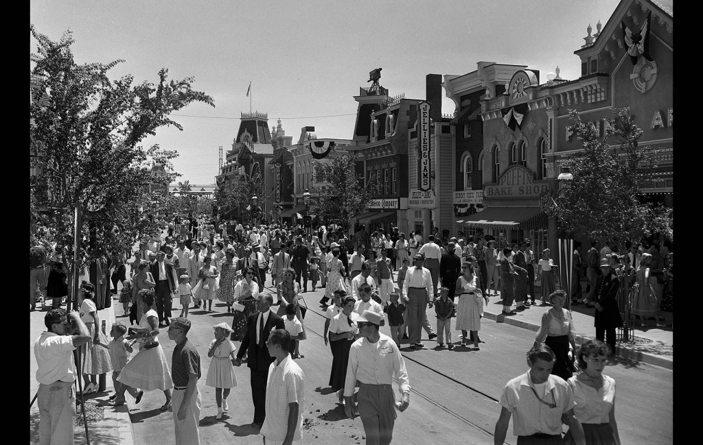"July 17, 1955: Main Street Disneyland during invitation only event later nicknamed ""Black Sunday."" Note the television camera on roof in center of image."